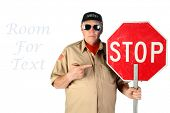 Man with Stop Sign. A red and white stop sign. hand held traffic control stop sign.  poster