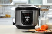 Modern Multi Cooker And Products On Table In Kitchen poster