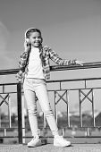 Girl Child Listen Music Outdoors With Modern Headphones. Kids Headphones Tested And Ranked Best To W poster