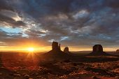 The Unique Landscape Of Desert At Sunrise In Monument Valley, Arizona, Usa. poster