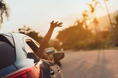 Hatchback Car Travel Driving Road Trip Of Woman Summer Vacation In Blue Car At Sunset,girls Happy Tr poster