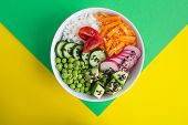 Vegan Poke Bowl With White Rice And Vegetables In The White  Bowl In The Center Of The Colorful Back poster