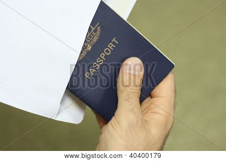 Removing A Passport From An Envelope