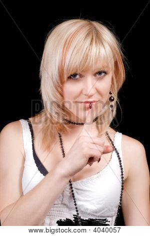 The Young Blonde With A Finger At Lips. Isolated