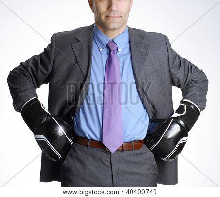 Bald head businessman using boxing gloves.
