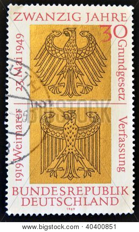 A stamp celebrates 50 years of the Weimar Constitution and 20 of the Basic Law of Bonn