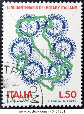 a stamp printed in Italy shows Rotary Emblem 50 anniversary of Rotary International Italian
