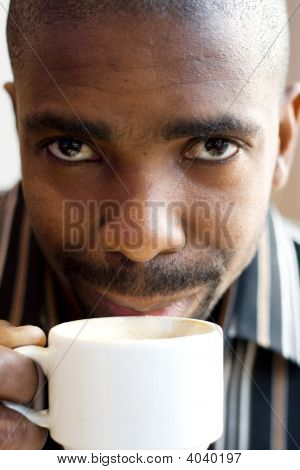 African Man Drink Coffee Closeup