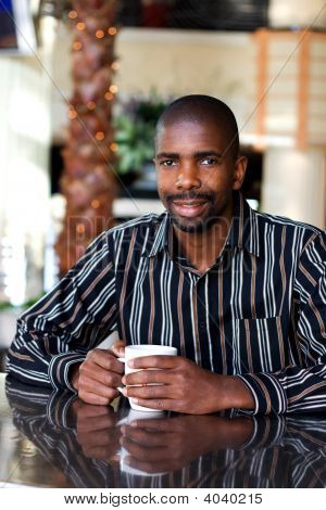 African Young Man In Cafe