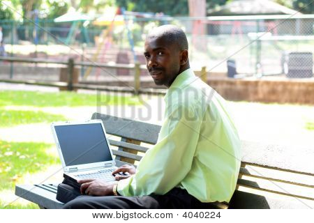 African Businessman Working On Laptop
