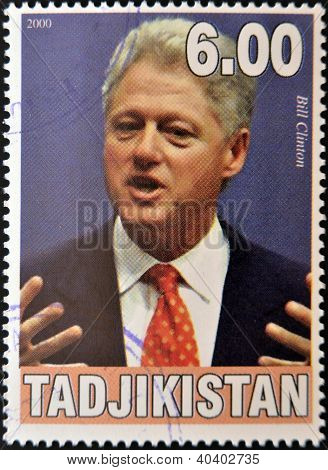 TAJIKISTAN - CIRCA 2000: A stamp printed in Tajikistan shows Bill Clinton circa 2000