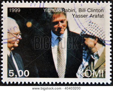 KOMI - CIRCA 1999: A stamp printed in Komi shows Yitzhak Rabin Bill Clinton and Yasser Arafat circa
