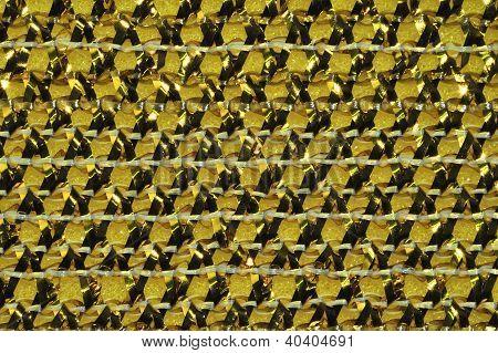 Golden plaited ribbons macro