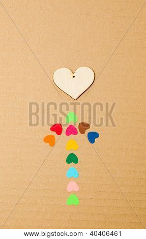 Arrow From Multicolored Paper Hearths With Wood Hearth