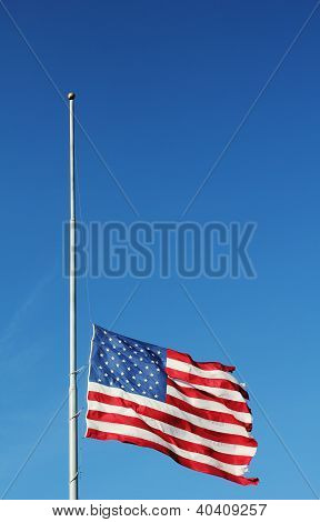 American flag flying at half staff in memory of Newtown massacre victims