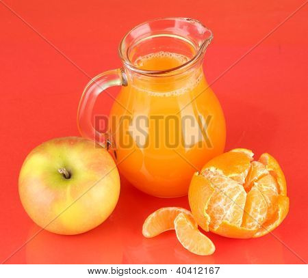 Full jug of multivitamin juice on color background