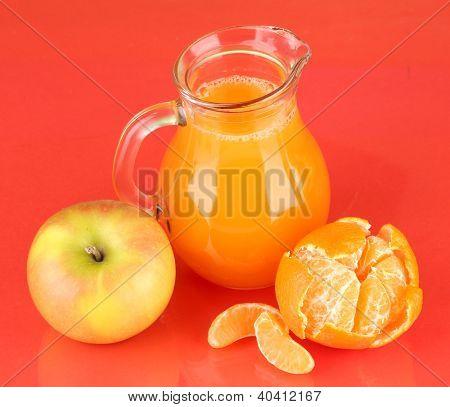 Full jug of multivitamin juice on color background
