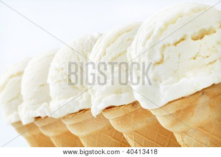 five ice cream scoops in the cones