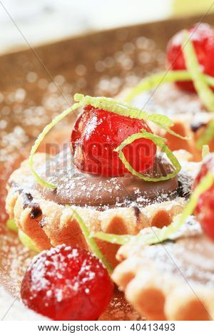 cupcake filled with chocolate cream and decorated with candied fruit