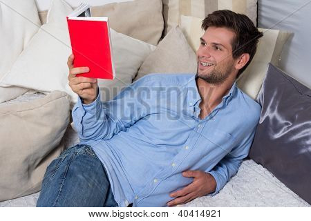 Young Brunette Man Reading A Book