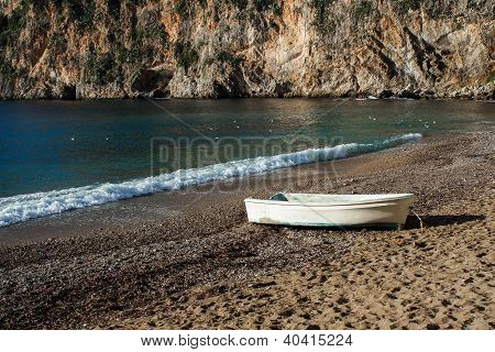An Old White Boat On A Beach In France