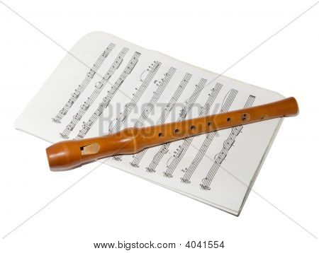 Recorder On A Sheet Music