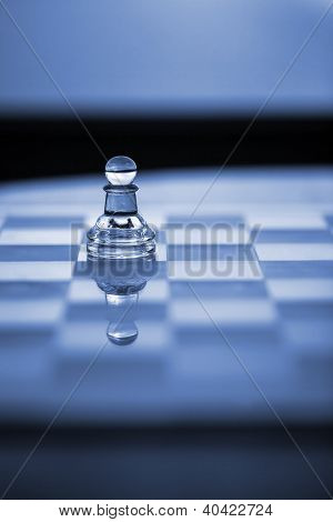 Chess Pawn On Chessboard With Reflection.