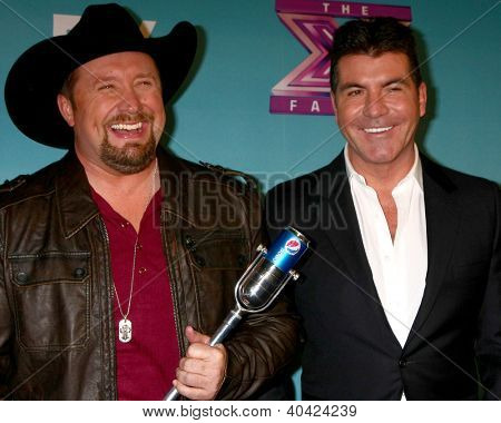 LOS ANGELES - DEC 20:  Tate Stevens - Winner of 2012 X Factor, Simon Cowell at the 'X Factor' Season Finale at CBS Television City on December 20, 2012 in Los Angeles, CA