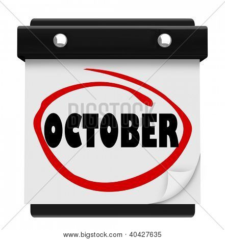 A wall calendar with the word October circled in red marker, reminding you of the change in months and time of autumn and Halloween