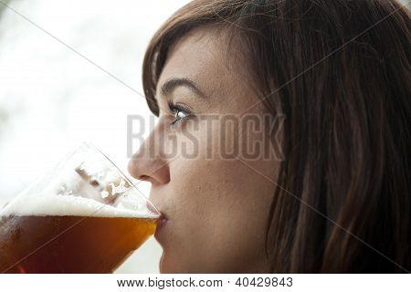 Young Woman Drinking Beer