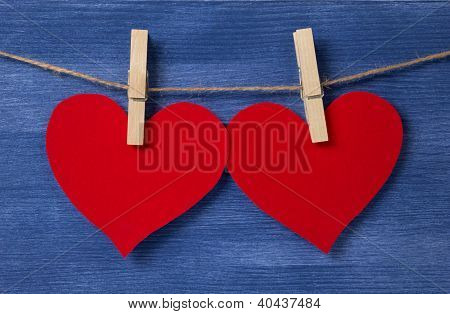 Two Paper Hearts Hanging On A Rope