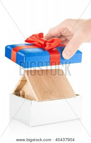 wooden house in a gift box