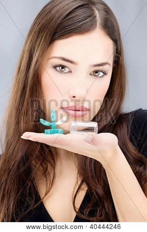 Woman Holding Contact Lenses Wash Container