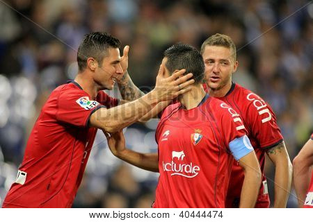 BARCELONA - NOV,10: Kike Sola(L), Miguel Flano(C) and David Timor(R) of Osasuna celebrate goal during a League match against Espanyol at the Estadi Cornella on November 10, 2012 in Barcelona, Spain