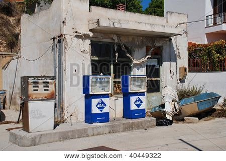 ALONISSOS, GREECE - SEPTEMBER 23: A derelict Aral petrol station at Votsi on September 23, 2012 on Alonissos island, Greece. The Aral petroloeum brand was founded in Germany in 1924.