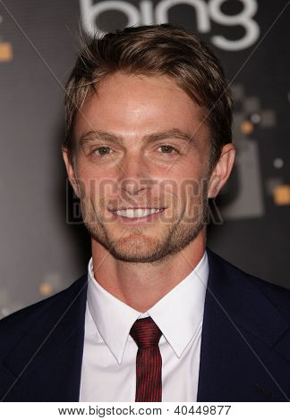 LOS ANGELES - AUG 10:  Wilson Bethel arriving to CW Premiere Party  on August 10, 2011 in Burbank, CA
