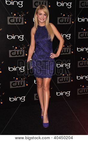 LOS ANGELES - AUG 10:  BRITT ROBERTSON arriving to CW Premiere Party  on August 10, 2011 in Burbank, CA