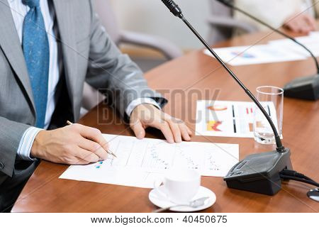 Businessman writing on  paper notes