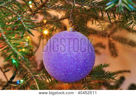 New Year Background, Christmas Tree With Purple Ball And Sparkling Garlands