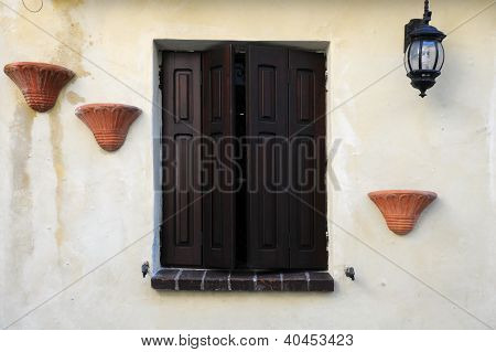 Window With Brown Shutters