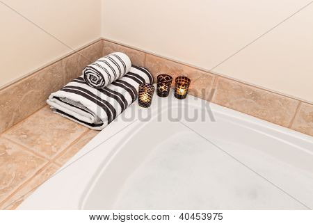 Towels, Candle Lights And Bath With Foam