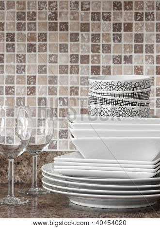 White Dishes And Plates On Kitchen Countertop