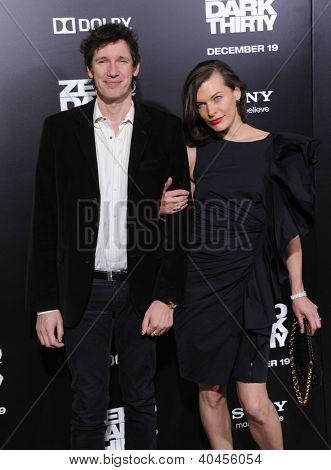 LOS ANGELES - DEC 19:  Milla Jovovich & Paul W.S. Anderson arrives to