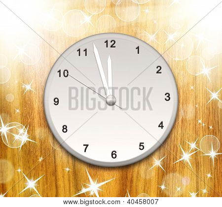 Clock on the wood texture showing 12 o'clock with bright light and many stars and bokeh. Christmas background