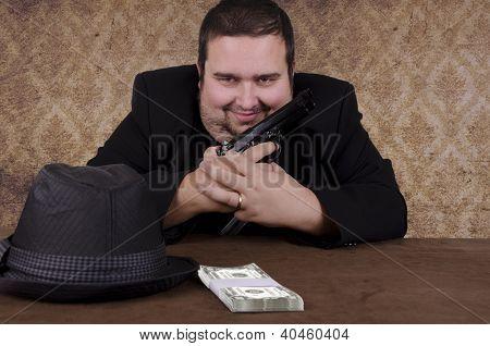 Smiling gangster holding handgun