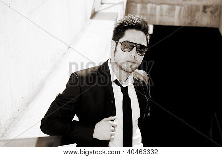 Portrait Of A Handsome Young Businessman With Sunglasses
