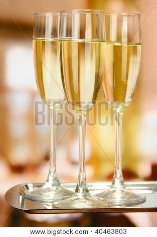 Corporate party: sparkling champagne glasses on tray