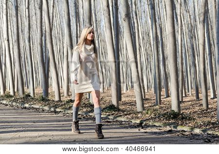 Beautiful Blonde Girl, Dressed With Beige Dress, Walking In A Rural Road