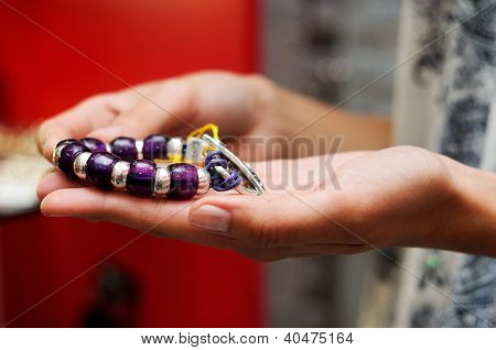 Hands Of Woman Taking A Bracelet In A Jewelry Store