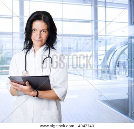 Happy Female Doctor At Hospital